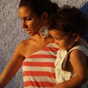 Saly Cortes, with one of her sons. [Photo from Saly]